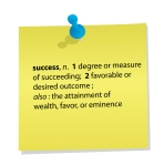 definition of success on yellow post-it note