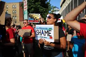 """Shame"" on Minnesota license plate protest sign"